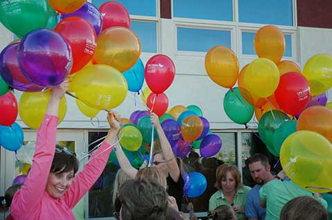 Students released over 100 balloons and butterflies.